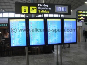 Monitors at the inner departure area of Alicante airport showing the boarding gates number of each flight